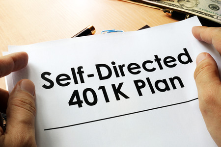Self directed 401k plan written on a paper. Stock Photo - 81299514