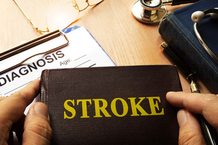 Book with name brain stroke disease. Medical concept.