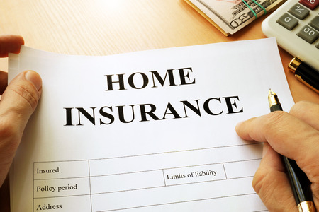 homeowners: Home insurance policy on a table.