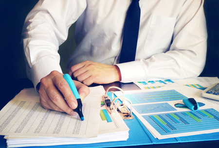 Businessman checking accounting data in an office. Standard-Bild