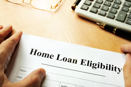 eligibility: Document with title Home Loan Eligibility on a Table. Stock Photo