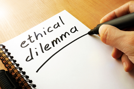 Ethical dilemma written in a note.
