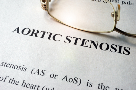 Page with title aortic stenosis and glasses. Stock Photo