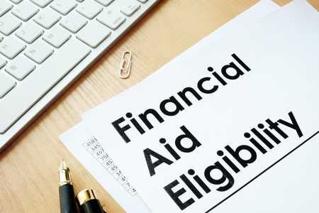 Financial Aid Eligibility and other financial documents. Reklamní fotografie - 83442715