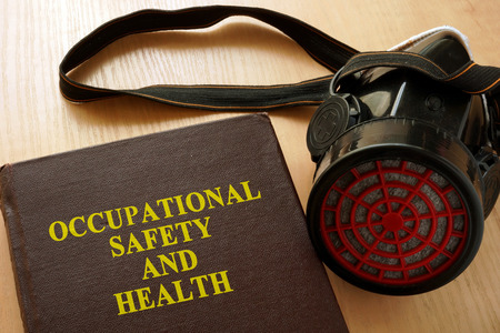 Book with title Occupational safety and health (OSH). Foto de archivo