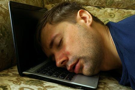 Overworked freelancer sleep on a laptop.