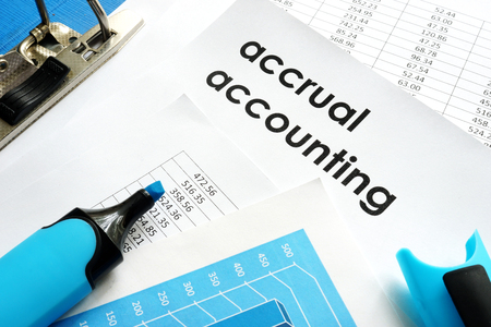 accrual: Accrual accounting document on a table. Stock Photo