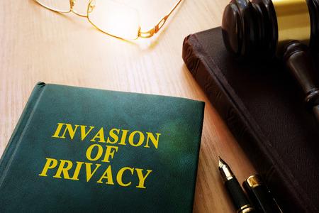 Invasion of Privacy book on a desk.