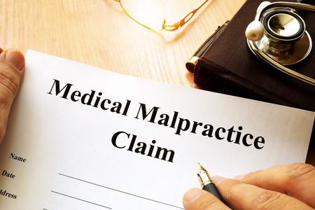 Medical Malpractice Claim on a table. Stock Photo