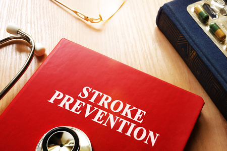 Stroke Prevention written on a book cover. Stock Photo