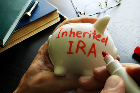 Inherited IRA written on a piggy bank. Reklamní fotografie