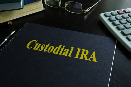 Book with title Custodial IRA on a desk. Stock Photo