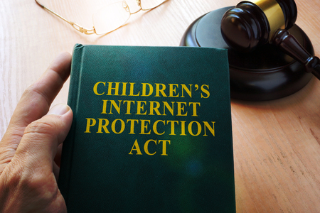Children's Internet Protection Act  CIPA on a table.