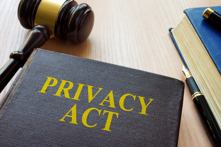 Book Privacy Act and gavel on a table. Stock Photo