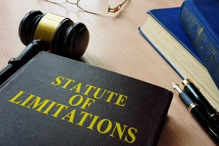 Statute of limitations (SOL) on a court desk. Banco de Imagens - 87841587