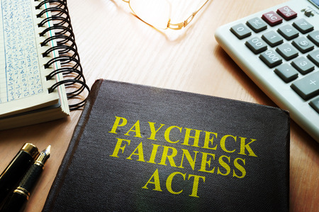 Book about Paycheck Fairness Act on a desk. Stok Fotoğraf