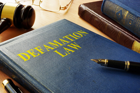 Book about Defamation Law and gavel.