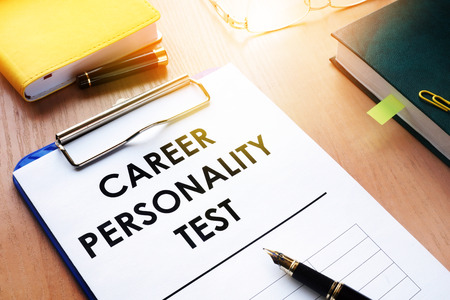 Clipboard with Career personality test on an office desk. Assessments concept.