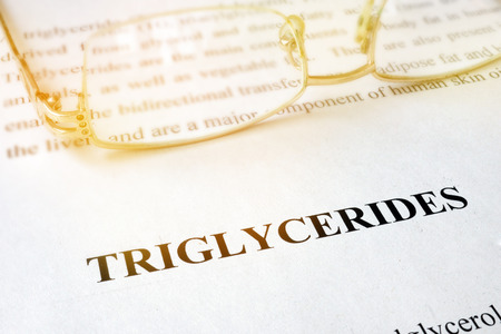 Page with word triglycerides and glasses. Stok Fotoğraf