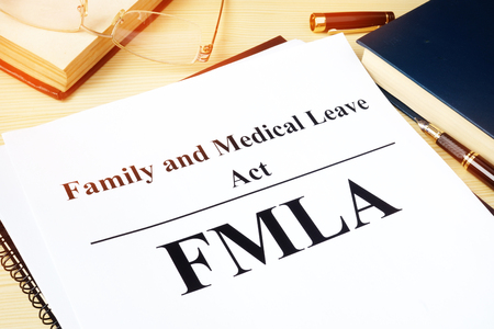 FMLA Family and Medical Leave Act on a desk. Stock fotó - 93772900
