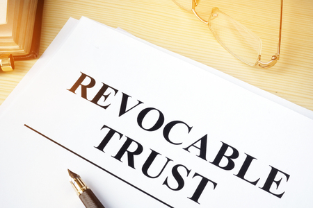 Revocable trust on a wooden desk.