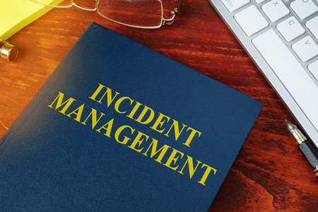 Incident Management concept. Book on the office desk. Foto de archivo