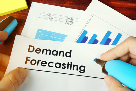 Man holding documents with name Demand Forecasting. 스톡 콘텐츠