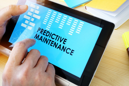 Man holding tablet with title Predictive Maintenance.