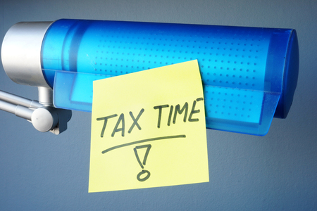Tax time written on a memory stick. Taxation concept. Stock Photo