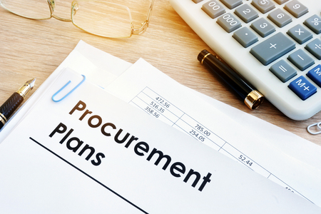Pile of documents with title Procurement Plans. 스톡 콘텐츠