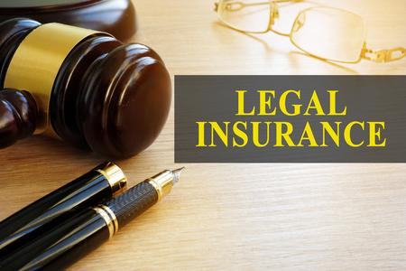 Legal insurance concept. Wooden gavel on a table. Фото со стока