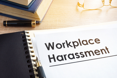 Documents about workplace harassment in an office. Foto de archivo - 95555582