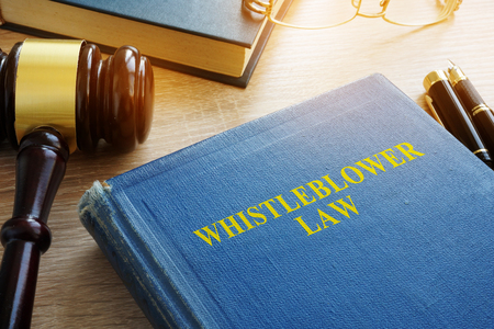 Whistleblower law on a court desk.