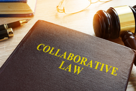 Collaborative Law or collaborative practice, divorce or family law on a desk.