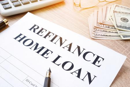 Refinance home loan application on a desk.