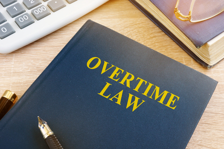 Overtime law and calculator in an office. Stock Photo