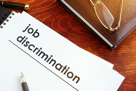 Papers about job discrimination on a desk. Stockfoto