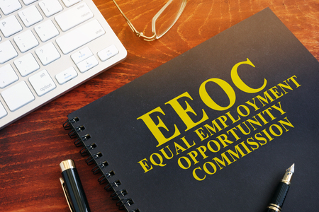 Equal Employment Opportunity Commission EEOC on a desk. Imagens