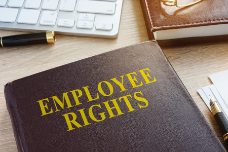 Book about employee rights in an office. Zdjęcie Seryjne