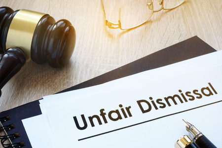 Documents unfair dismissal and gavel in a court.