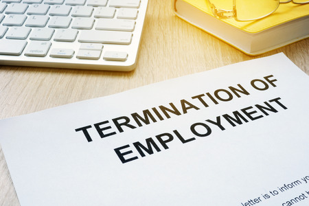 Termination of Employment on an office desk. 写真素材