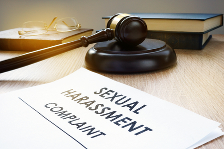 Sexual harassment complaint and gavel on a desk.