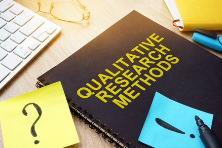 Qualitative research methods and sticks on a desk. Stockfoto