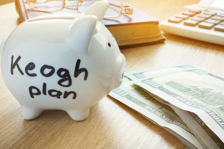 Keogh plan written on a piggy bank. Stock Photo - 101545436