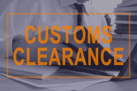 Customs Clearance concept. Man is working with documents.
