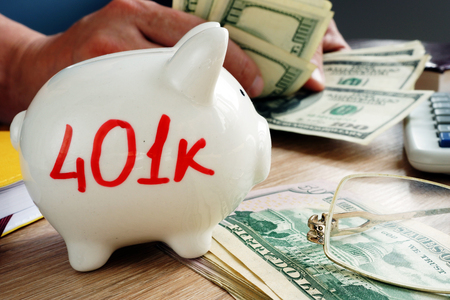 401k on a piggy bank. Savings for retirement. Stock Photo
