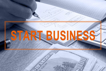 Start business. Man writing in a note.
