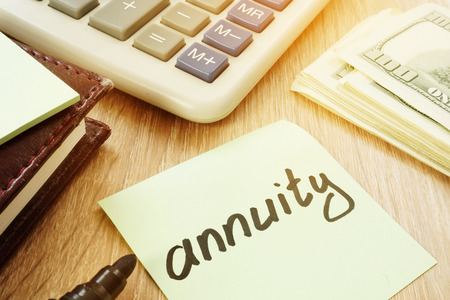 Annuity sign and calculator. Money for savings. Foto de archivo