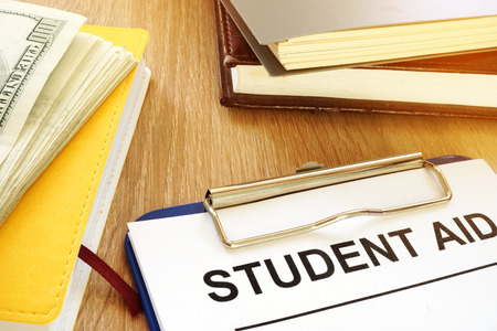 Student aid form and money for education.