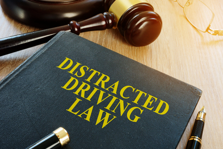 Distracted driving law and gavel on a desk.